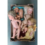 A BOX CONTAINING A SELECTION OF DOLLS AND DOLL PARTS