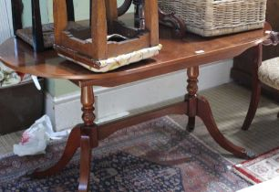A REPRODUCTION YEW WOOD DINING TABLE