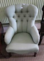 A SAGE GREEN TRELLIS UPHOLSTERED BUTTON BACK ARMCHAIR with serpentine fronted seat, supported on
