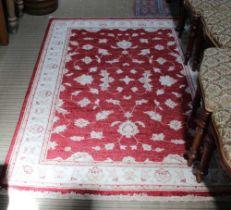 A HAND WOVEN PAKISTANI WOOLLEN FLOOR CARPET based on a Zeigler design