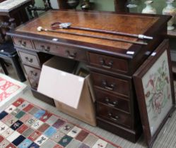 A REPRODUCTION MAHOGANY FINISHED TWIN PEDESTAL DESK, of typical form and construction, with well