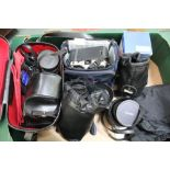 A BOX CONTAINING A SELECTION OF CAMERAS AND ADDITIONAL EQUIPMENT