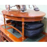 A REPRODUCTION YEW WOOD FINISHED OVAL TOPPED COFFEE TABLE on four carved leaf and reeded legs,
