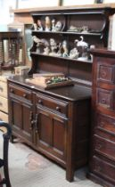 AN ERCOL BRANDED KITCHEN DRESSER with low twin shelf plate rack back, over two inline drawers &