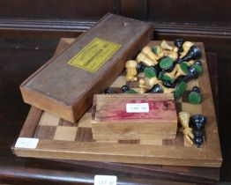 TWO WOODEN CHESS BOARDS together with a selection of chessmen & draughts