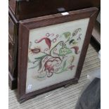 A FIRST QUARTER 20TH CENTURY WOODEN FRAMED FOLDING FIRE SCREEN, with floral design stitched