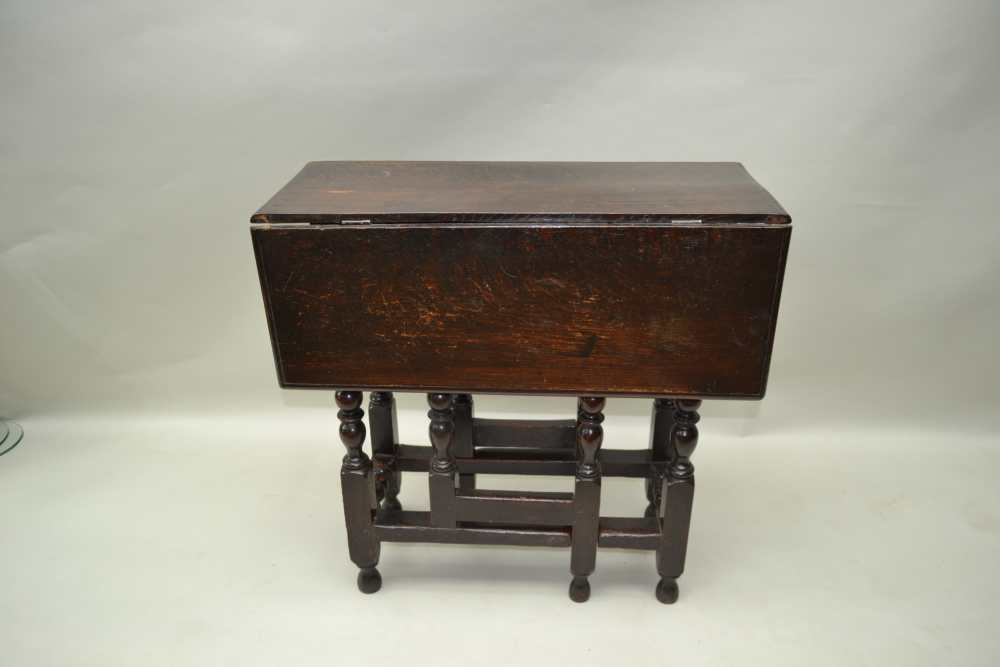 A PART 18TH CENTURY OAK SMALL DROPLEAF, the frame with ring turnings, later drop leaf top, 73cm x