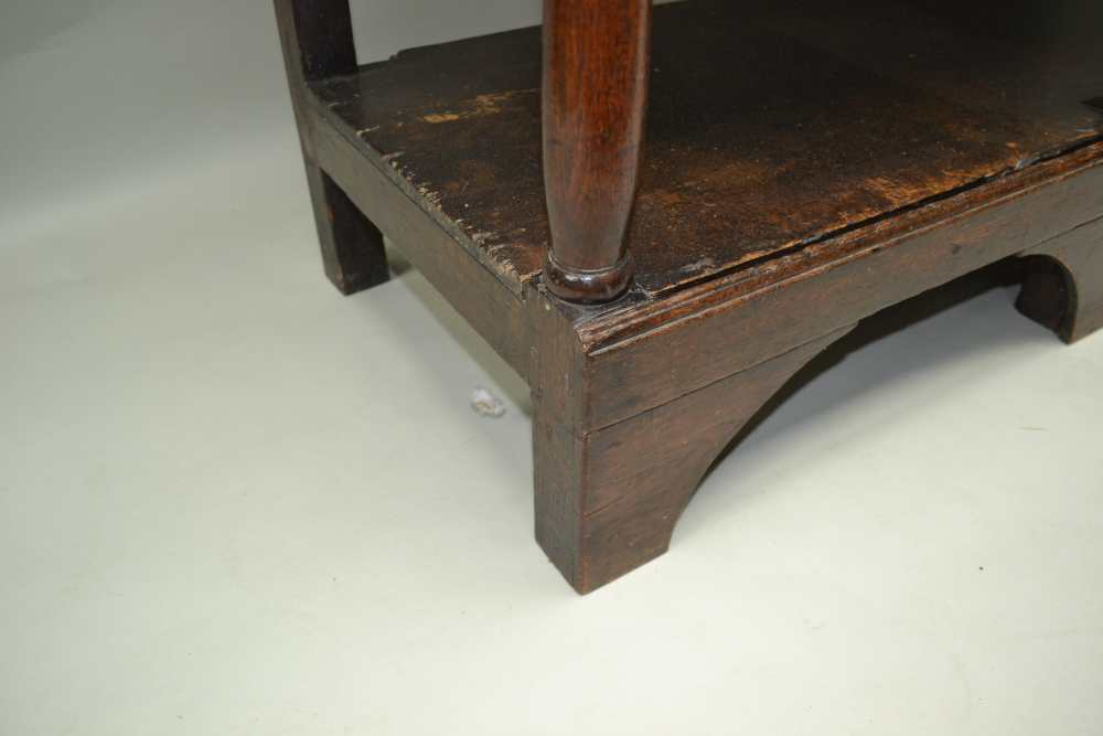A LATE GEORGE III OAK DRESSER, the base fitted three drawers, with brass handles over shaped aprons, - Image 4 of 5