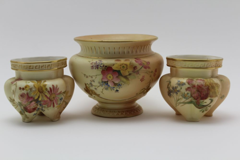 A ROYAL WORCESTER PORCELAIN BOWL. Blush ivory ground, moulded, floral painted and gilded