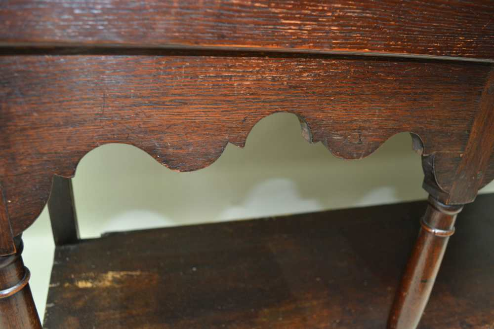A LATE GEORGE III OAK DRESSER, the base fitted three drawers, with brass handles over shaped aprons, - Image 3 of 5