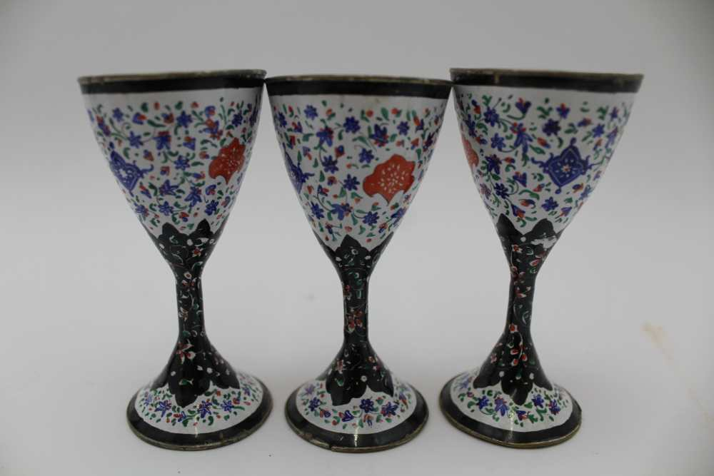 AN ISLAMIC PERSIAN ENAMEL COPPER DISH, together with a tray 23cm wide and three stemmed drinking - Image 5 of 5