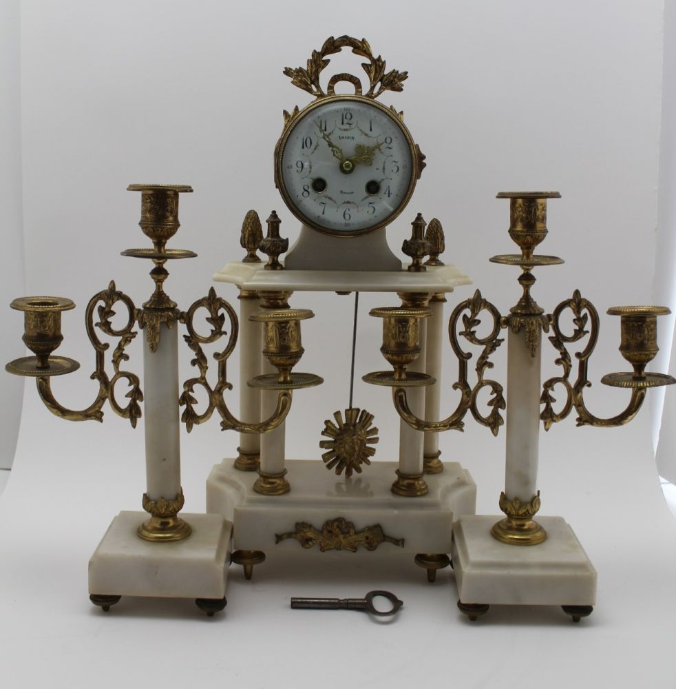 A LATE 19TH CENTURY FRENCH WHITE MARBLE & GILT BRASS CLOCK GARNITURE, the clock of Portico type, the