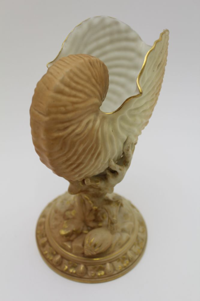 A PAIR OF ROYAL WORCESTER PORCELAIN NAUTILUS SHELL VASES, raised on coral moulded stems and shell - Image 3 of 4