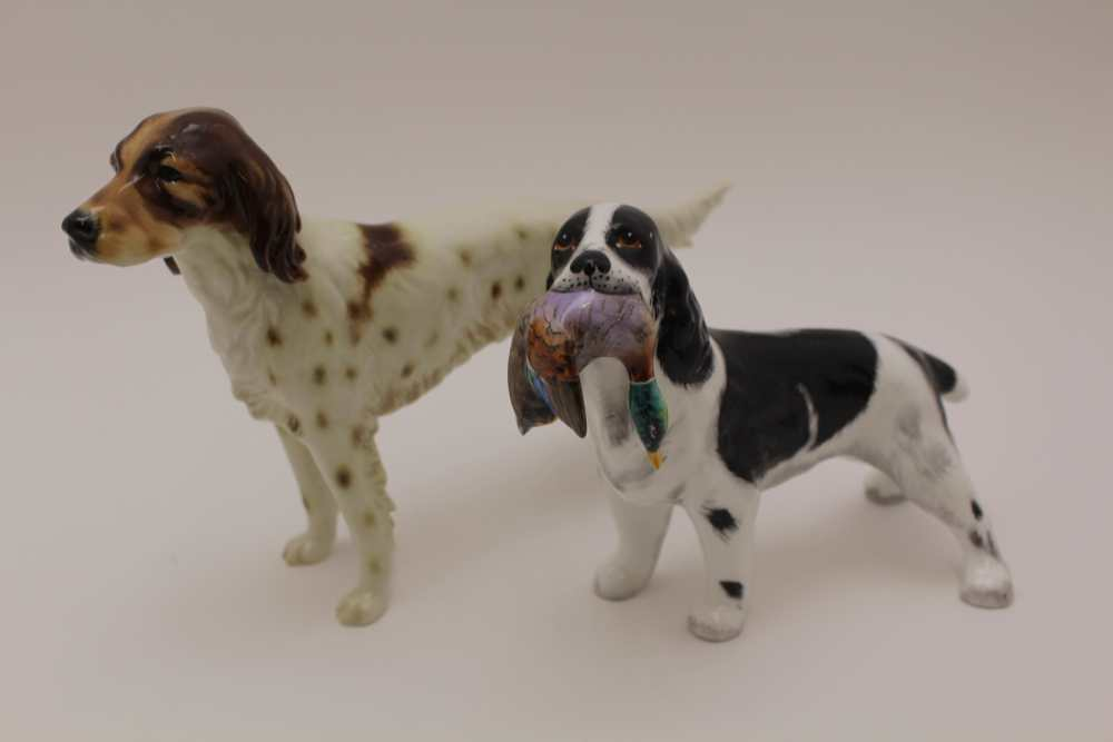 A GOEBEL POTTERY BROWN & WHITE IRISH SETTER DOG, factory marked, 16cm high, together with a bone
