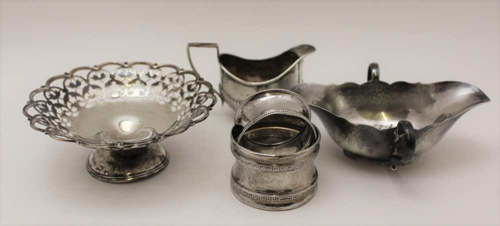 C.S. HARRIS AND SONS LTD. A SILVER JUG WITH HANDLE EITHER SIDE AND POURING LIP AT EITHER END, London