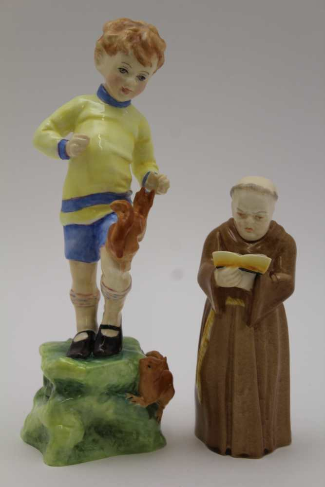 A ROYAL WORCESTER BONE CHINA MONK CANDLE SNUFFER, 12cm high, together with 'October' modelled by F.