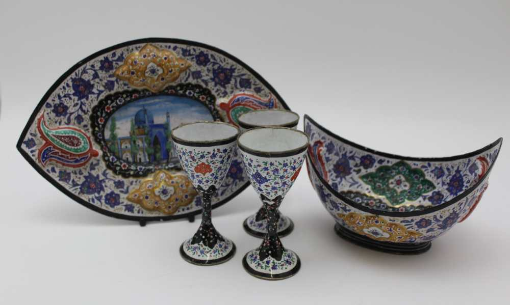 AN ISLAMIC PERSIAN ENAMEL COPPER DISH, together with a tray 23cm wide and three stemmed drinking