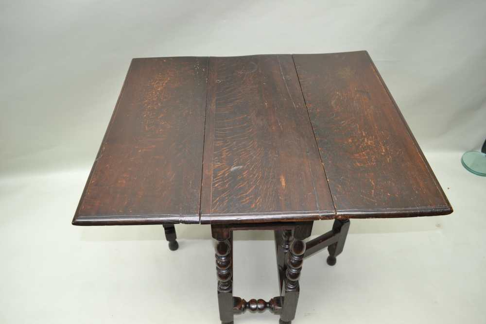A PART 18TH CENTURY OAK SMALL DROPLEAF, the frame with ring turnings, later drop leaf top, 73cm x - Image 2 of 3