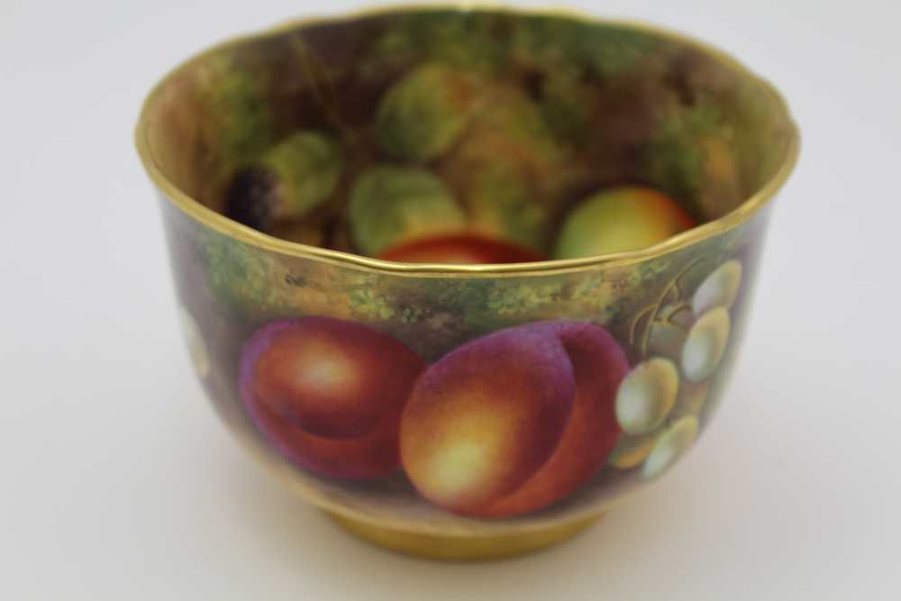 A ROYAL WORCESTER HAND PAINTED PORCELAIN BOWL, painted in the round with fruit, also internally
