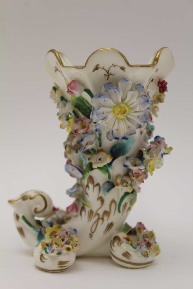 A 19TH CENTURY PORCELAIN CORNUCOPIA VASE, floral encrusted, painted and gilded, possibly Derby, hand
