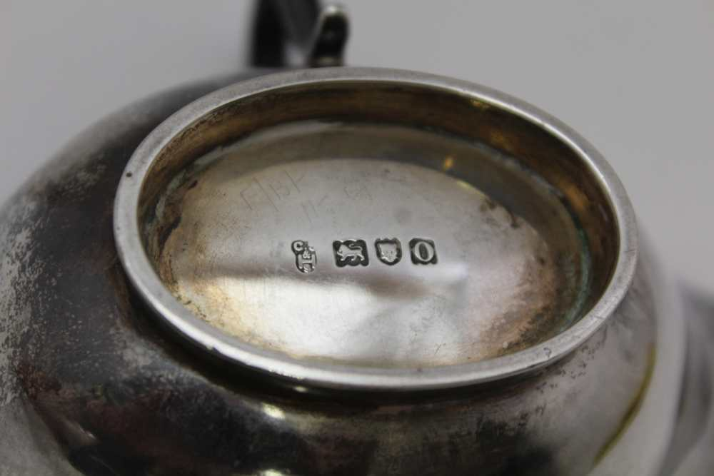 C.S. HARRIS AND SONS LTD. A SILVER JUG WITH HANDLE EITHER SIDE AND POURING LIP AT EITHER END, London - Image 4 of 8