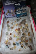 A BOX CONTAINING AN EXTENSIVE SELECTION OF WADE WHIMSEY ANIMALS together with 2 paperback books