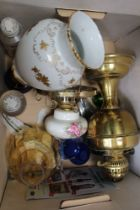 A BOX CONTAINING OIL LAMPS together with chromed pocket lighters, etc
