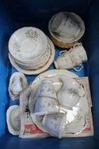 A BLUE CRATE CONTAINING A ROYAL ALBERT 'HAWORTH' PATTERNED PART TEA SERVICE