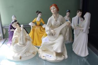 A SELECTION OF PORCELAIN FIGURINES the majority Royal Doulton