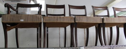 A SET OF SEVEN REGENCY DESIGN MAHOGANY DOUBLE BAR BACKED DINING CHAIRS with overstuffed