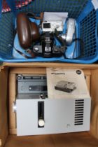 A CRATE CONTAINING A SELECTION OF CAMERAS together with a boxed Leitz slide projector