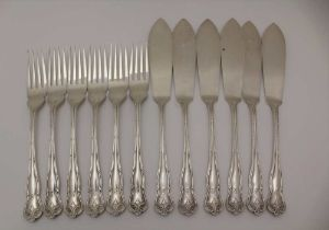 H. PIDDIUCK & SONS, A SET OF SILVER FISH KNIVES & FORKS FOR SIX SETTINGS, decorative handles