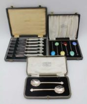 COOPER BROTHERS & SONS A cased pair of silver jam spoons, with trefid handle tips, Sheffield 1926 in