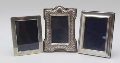 A VICTORIAN DESIGN DECORATIVELY SILVER MOUNTED PHOTOGRAPH FRAME, fluted decoration, fabric easel