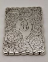 WILLIAM M. HAYES, AN EDWARDIAN SILVER VISITING CARD CASE, floral chased decoration, monogrammed,