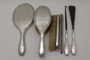 GOLDSMITHS & SILVERSMITHS CO. LTD, A SET OF SIX SILVER MOUNTED DRESSING TABLE VANITY ITEMS, to