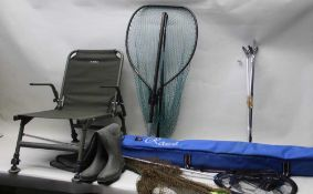 A SELECTION OF FISHING EQUIPMENT to include slingshots, feeders, hooks, weights, weighing scales,