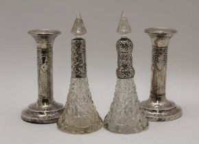 A PAIR OF EDWARDIAN SILVER CANDLESTICKS, embossed ribbon and bell husk swags on circular bases,