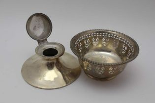 A SILVER CAPSTAN DESIGN INKWELL, hinged cover, base 11.5cm dia, together with a Birks sterling