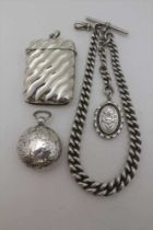 A GRADUATED LINK SILVER WATCH CHAIN, with clip and 'T' bar, fitted with a silver locket, together