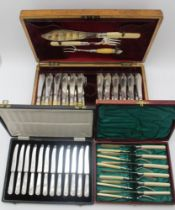 AN OAK CASE OF SILVER FISH KNIVES & FORKS FOR TWELVE SETTINGS, fitted to the lid interior with