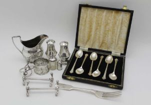 A COLLECTION OF SILVER ITEMS, includes a cream jog, pair of knife rests, condiments, napkin rings,
