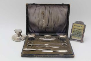 A MANICURE CASE contains a quantity of silver mounted requisites, the nail buffer is hallmarked