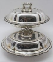 A PAIR OF SILVER PLATED CSHION FORM VEGETABLE TUREENS, serpentine gadrooned rims, the covers