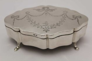 JONES & CROMPTON, A SILVER TABLE CASKET, serpentine form, the hinged lid engraved with ribbon swags,