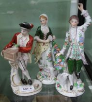 A PAIR OF CONTINENTAL PORCELAIN MALE & FEMALE FIGURES in the style of Sitzendorf together with one