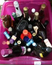 A LARGE CERISE PLASTIC CRATE OF ALCOHOLIC BEVERAGES