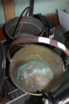 AN EASTERN DESIGN COPPER POT, together with a 19th century brass preserve pan, with fixed iron