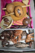 A BOX CONTAINING A SELECTION OF PREDOMINANTLY ETHNIC WOODEN WARES, to include carved animals