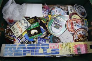 A BOX CONTAINING A SELECTION OF HOME BAR EQUIPMENT the majority pump badges